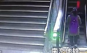 Mother and toddler take a tumble down on an escalator
